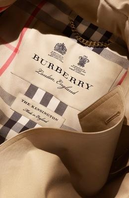 Burberry tartan pattern trench coat.
