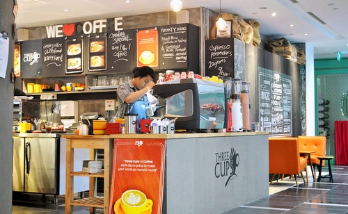 Three Cups Coffee Co. cafe One Raffles Place shopping centre Singapore.