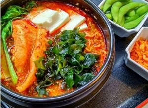 JustAcia restaurant's Kimchi Beandcurd Spicy Chicken Soup with Noodles meal, available in Singapore.