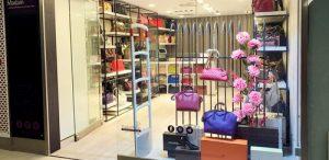Madam Milan bag store at Raffles Place MRT Station in Singapore.