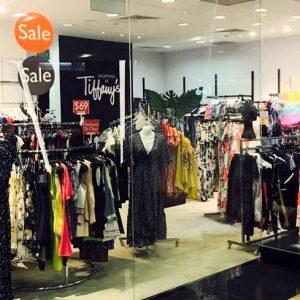 Shopping at Tiffany's clothing shop at 112 Katong mall in Singapore.