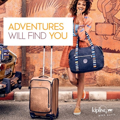 "Kipling travel bags ad: ""Adventures Will Find You""."