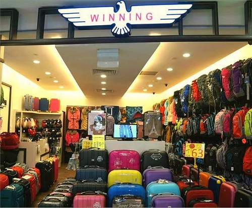 Winning travel & coldwear store Lot ONE Singapore.