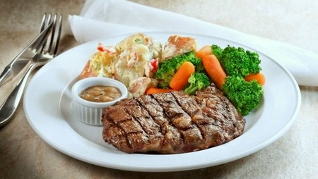 Astons Specialties restaurant's Prime Steer Ribeye meal Singapore.