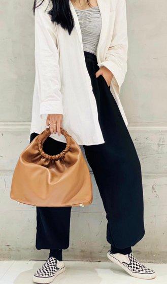 Gracious Aires Handheld Brown Leather Bag.