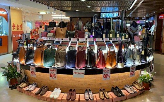 Jon Louis Raffles City - Leather Goods Store in Singapore.