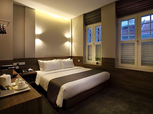 Deluxe guest room at Arcadia Hotel Singapore.