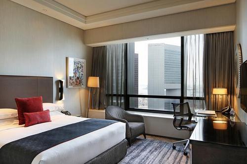 Executive room at Carlton City Hotel Singapore.