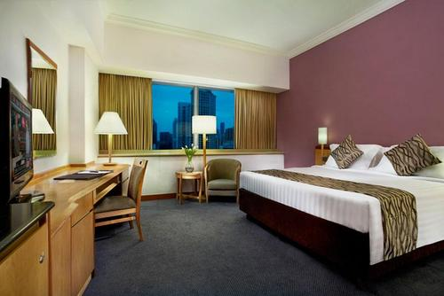 Guest room at Furama RiverFront Hotel Singapore.
