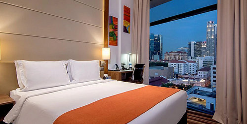 Guest room at Holiday Inn Express Singapore Clarke Quay hotel.