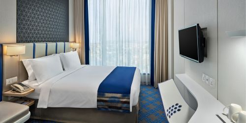 Guest room at Holiday Inn Express Singapore Katong hotel.