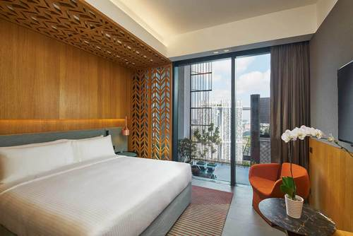 Guest room at Oasia Hotel Downtown Singapore.