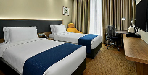Guest room at Holiday Inn Express Singapore Orchard Road hotel.