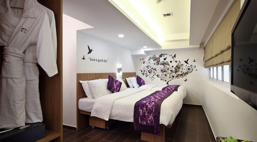 Guest room at Hotel Clover The Arts Singapore.