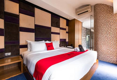 Guest room at RedDoorz Plus Little India hotel in Singapore.